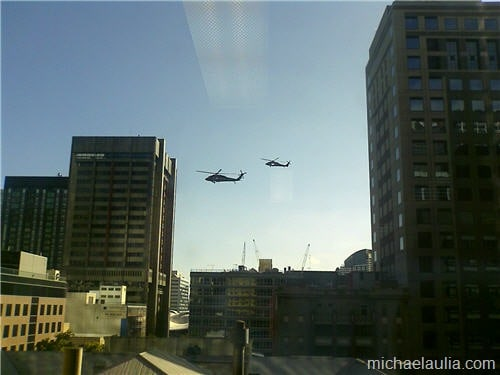 blackhawk hovering building in the city