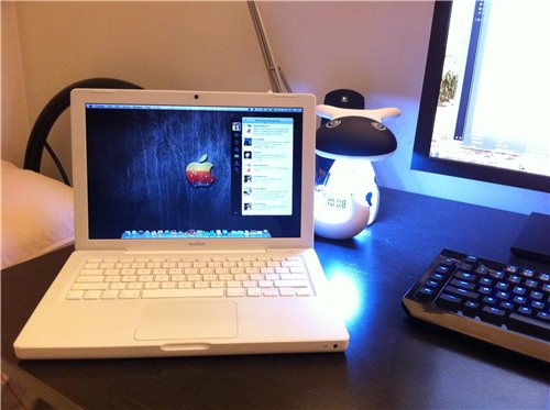 Cute Cow LED next to Macbook